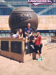 The ticket office interns posed with the baseball statue on the plaza.